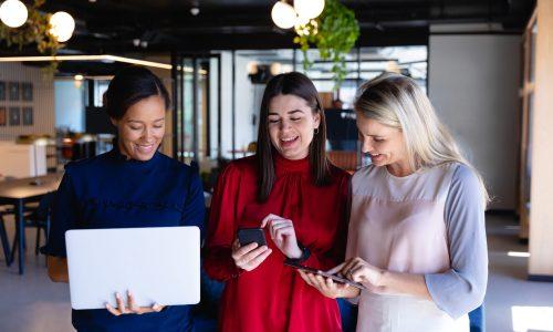 business-women-using-digital-technology-A9V88E2-scaled.jpg